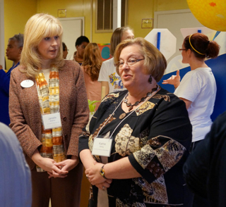 Janelle Beamer, left, director of public information and events for the South Carolina Program for Infant/Toddler Care, and Kathie Boling, assistant director of the S.C. Child Care Resource and Referral Network, await the announcement of the new ABC Grow Healthy program at a press conference Feb. 13.